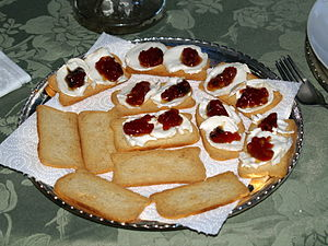 English: Melba toast topped with goat cheese a...