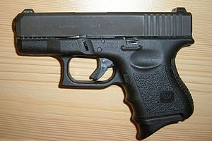 English: Subcompact Glock 26 with tritium nigh...