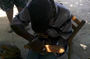 Roadside Jamaican woodcarver outside of Bodden...