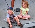 Two girls sitting on a sidewalk - 20090915.jpg
