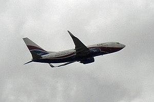 English: An Arik Air's Boeing 737 on take off ...