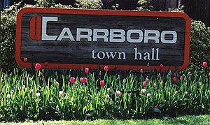 The town hall sign for , surrounded by tulips ...