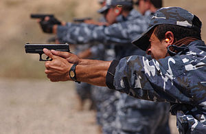 Iraqi police officers undergoing firearms trai...