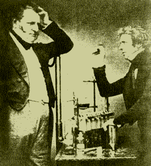 English chemists Michael Faraday and John Fred...