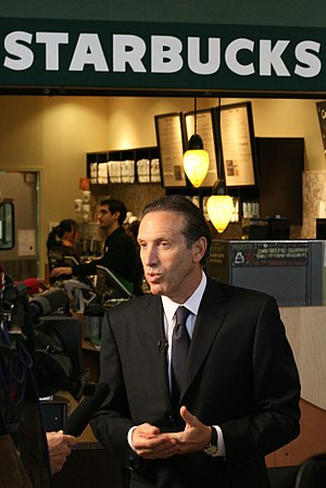 Starbucks Chairman Howard Shultz talks to the ...