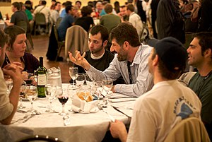People talking at Wikimania 2009 welcome dinner.