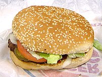A hamburger with a sesame seed roll.