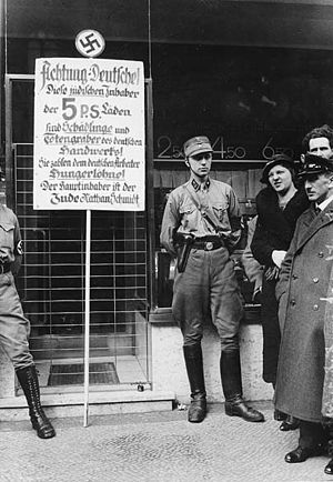 Members of the SA in front of a Jewish shop du...