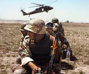 An Iraqi unit prepares to board a US Blackhawk...