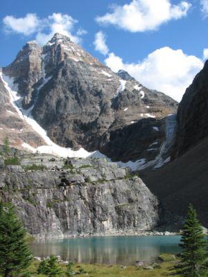 Ringrose Peak soars above a pond near Lake O'H...