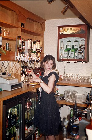 English: A student working as a barmaid in a B...
