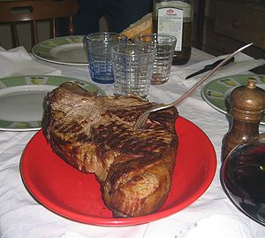 Bistecca alla Fiorentina is a grilled T-Bone-S...