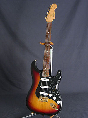 A Fender Stratocaster with sunburst finish, on...