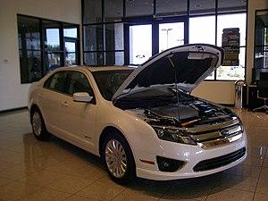 White Ford Fusion Hybrid 2010.