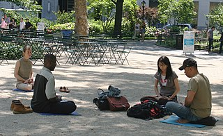 https://i1.wp.com/upload.wikimedia.org/wikipedia/commons/thumb/b/b2/Meditating_in_Madison_Square_Park.jpg/320px-Meditating_in_Madison_Square_Park.jpg