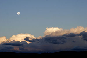 Moon over cumulus clouds