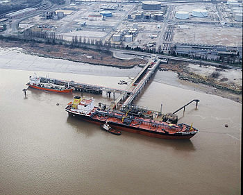 A tanker is unloading in the Pauillac haven, w...