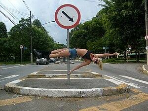 Pole dancer using a street pole