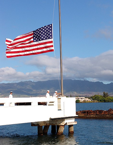Caption from Wikipedia:  Pearl Harbor, Hawaii (May 31, 2004) - Sailors assigned to ships based at Pearl Harbor bring the flag to half-mast over the USS Utah Memorial on Ford Island in honor of Memorial Day May 31, 2004. U.S. Navy photo