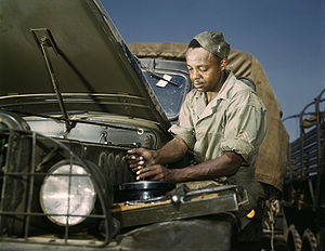 "Original caption ""Colored mechanic, motor..."