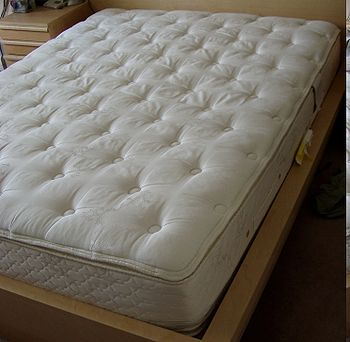 "A pillowtop mattress (U.S. size ""queen"")"