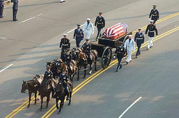 Ronald Reagan's casket, on a horse-drawn caiss...
