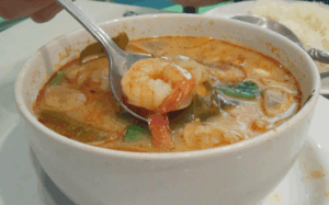 Tom yum kung - hot soup with shrimps, Thailand.