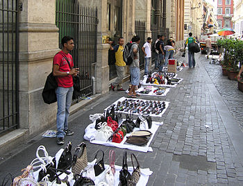 Street hawkers selling bags and sunglasses in ...