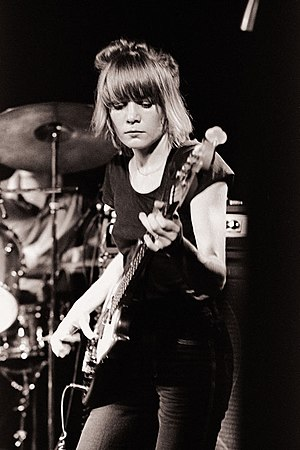 Tina Weymouth playing bass guitar with Talking...