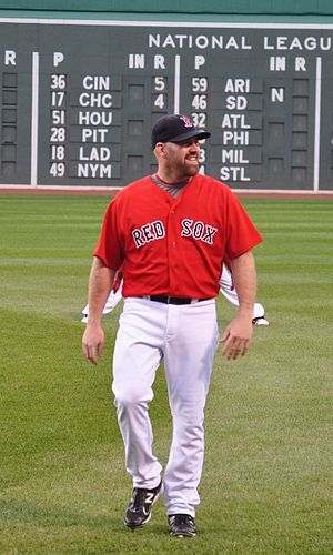 English: Kevin Youkilis is warming up before t...