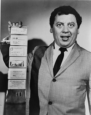 Marty Allen, American comedian, holding wallet...