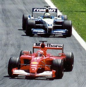 Michael Schumacher (Ferrari) leads brother Ral...