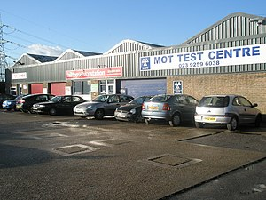 English: Cars waiting at the MOT test Centre i...