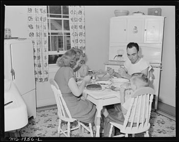 P.C. Goins, section foreman, and family eat di...