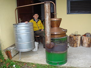 English: Traditional distillation of rakia (pl...