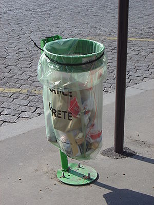 A public waste bag in Paris displaying the ins...