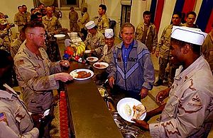 U.S. President George W. Bush meets with troop...