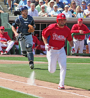 Shane Victorino running to first base during S...