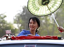 Aung San Suu Kyi arrives to give a speech to the supporters during the 2012 by-election campaign at her constituency Kawhmu township, Myanmar on 22 March 2012.