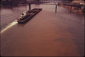 BARGE ON THE MONONGAHELA RIVER SHOWS EFFECTS O...