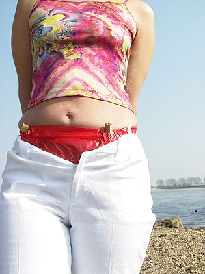 English: A woman with pampers and red PVC-diap...