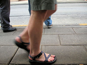 An example of walking in sandals.