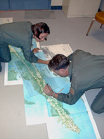 English: Langley Air Force Base, VA, October 13, 1999 -- Air Force pilots survey maps of designated mosquito spraying areas in Southeast Virginia. Spraying is taking place due to the risk of encephalitis and mosquito infestation. Photo by Liz Roll/ FEMA News Photo