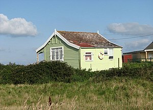 English: Perched above the beach One of the ho...