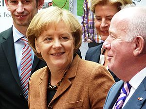 German Chancellor Angela Merkel at a booth on ...