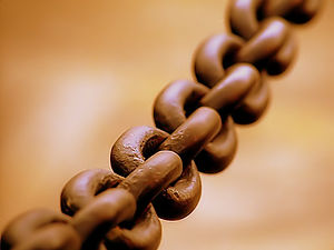 A broad metal chain.