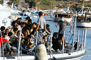 English: Migrants arriving on the Island of La...