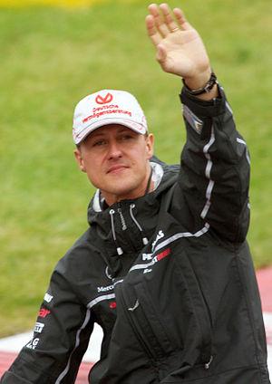 Michael Schumacher dalam parade pembalap jelan...