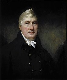 Portrait of male with white hair wearing a white cravat and blue jacket.
