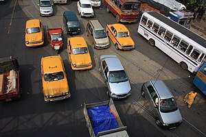 English: Taxis, cars and buses stuck in the ev...